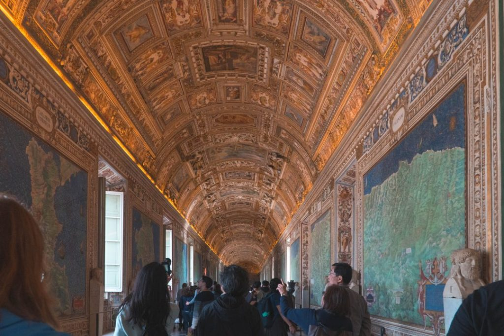 many people in the gilded hallway of the vatican museum in rome - one of the biggest rome travel mistakes you can make is thinking that there will ever NOT be crowds!