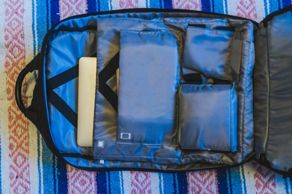 the laptop, kindle, and tech pockets on the back of the nayosmart almighty backpack