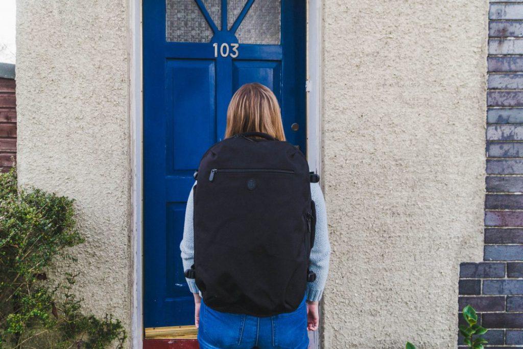 addie wearing a black tortuga backpack