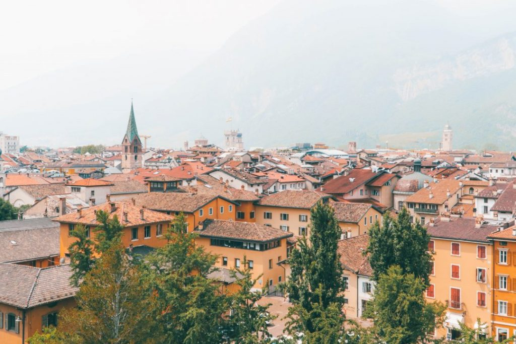 a birds-eye view of trento, italy, one of the best solo female travel destinations