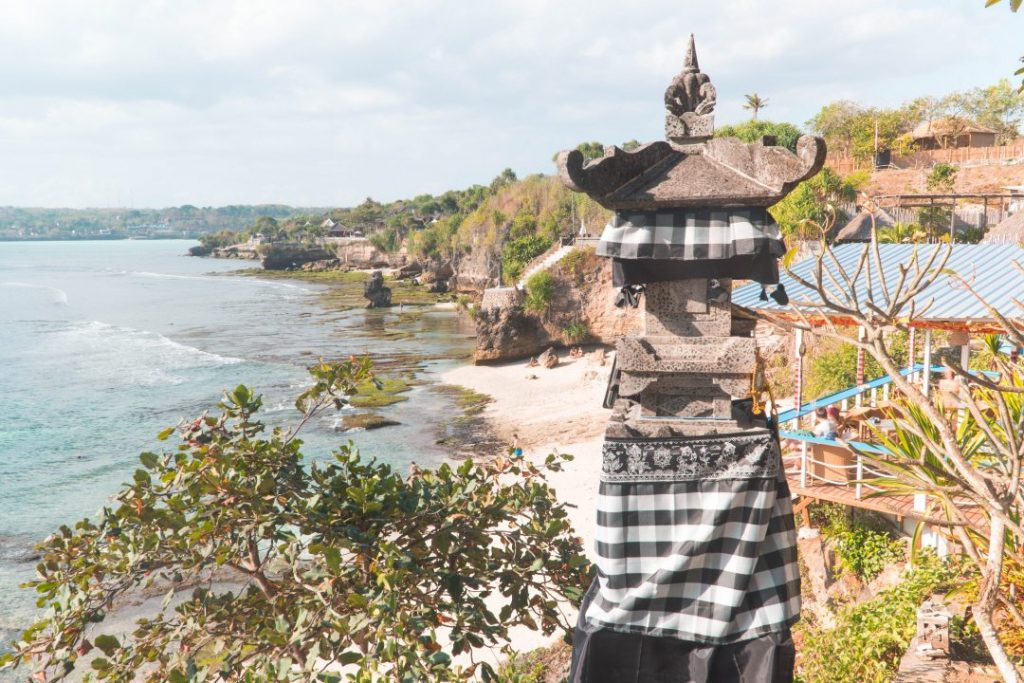 a pillar wrapped in gingham cloth on the cliffs of nusa cenigan