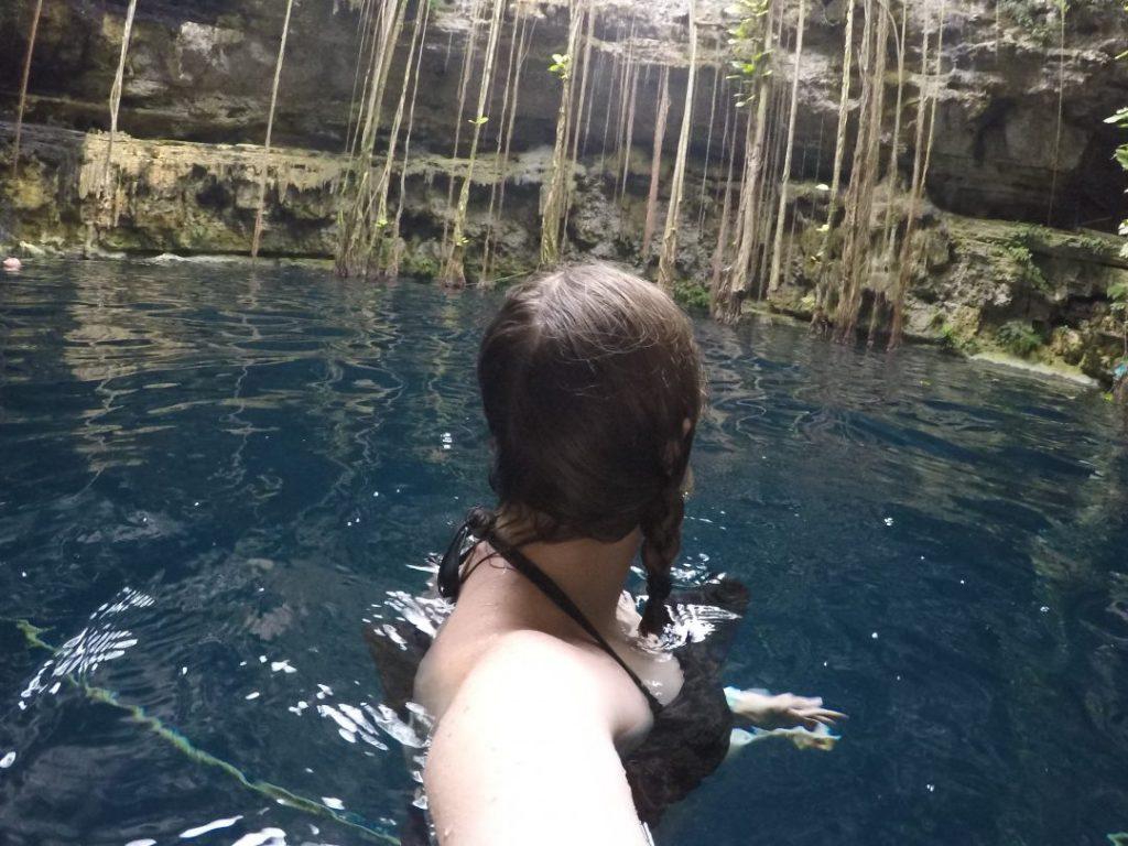 Addie swimming in Cenote San Lorenzo Oxman
