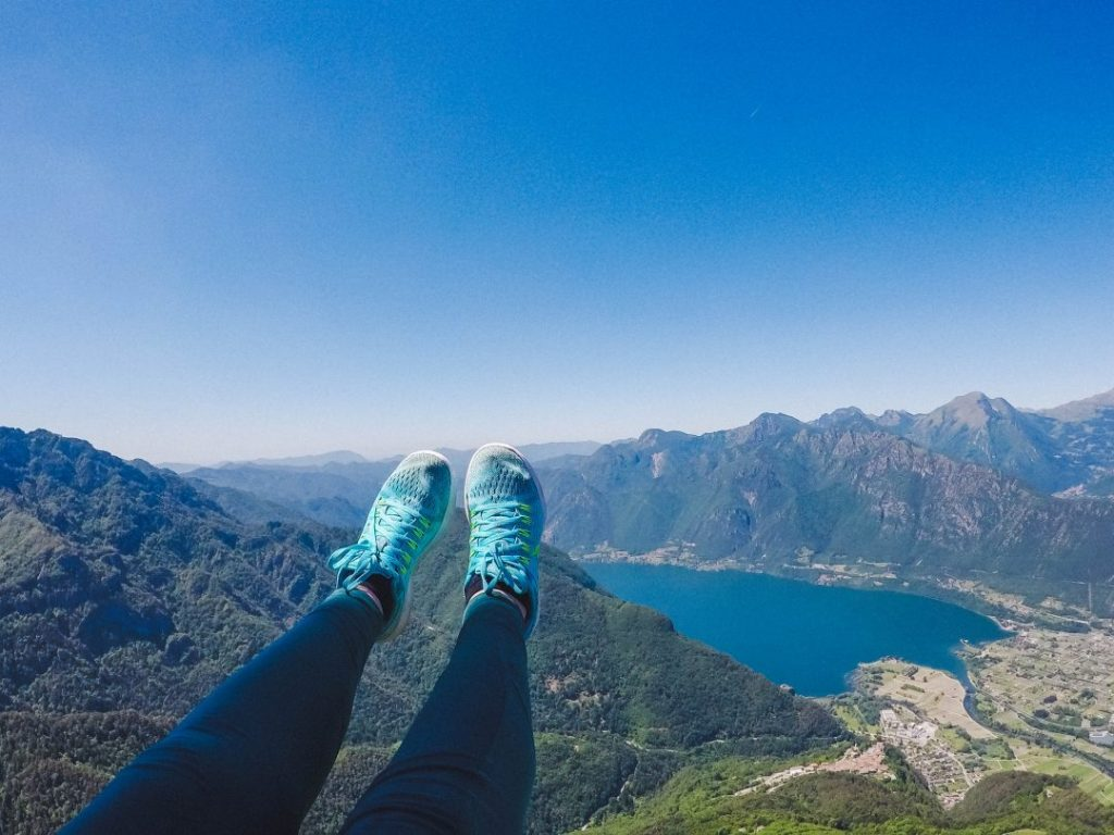 Addie's feet in the air, flying over Lake Idro