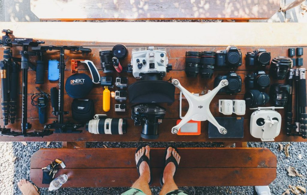 an overhead shot of a ridiculous amount of camera gear