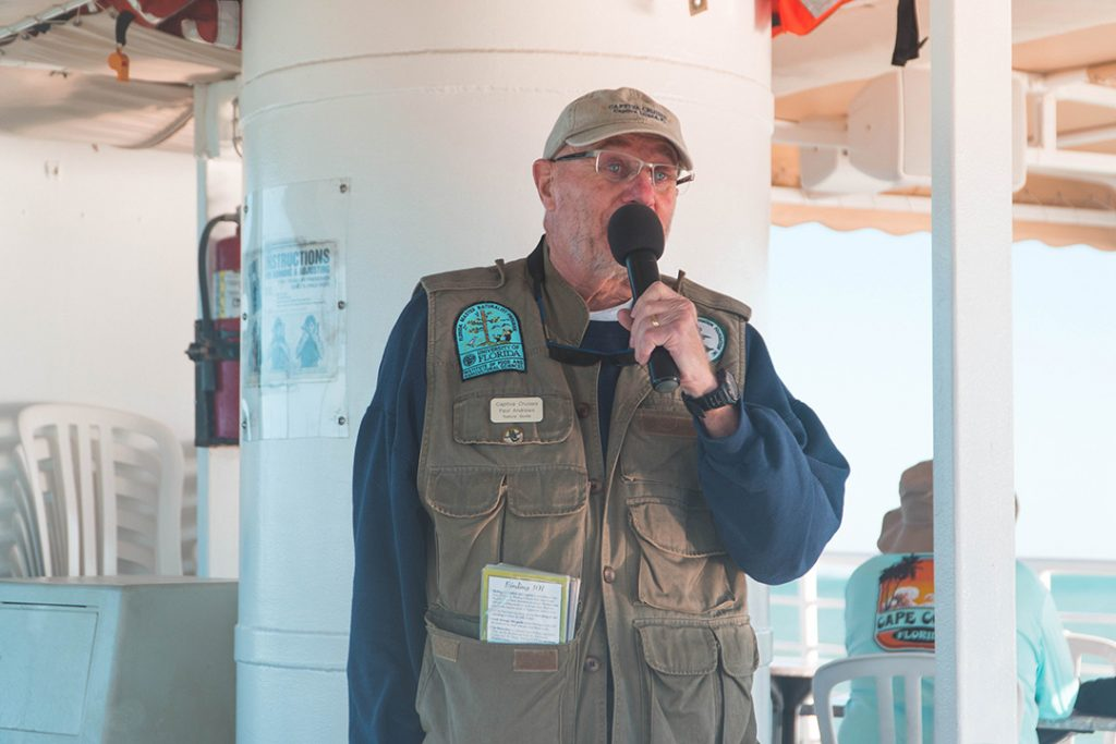 a JN Ding Darling guide giving commentary on the Captiva dolphin cruise