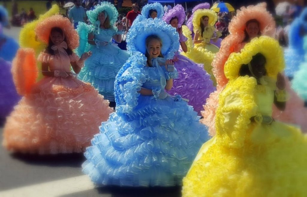 young girls in huge, frilly colorful dresses