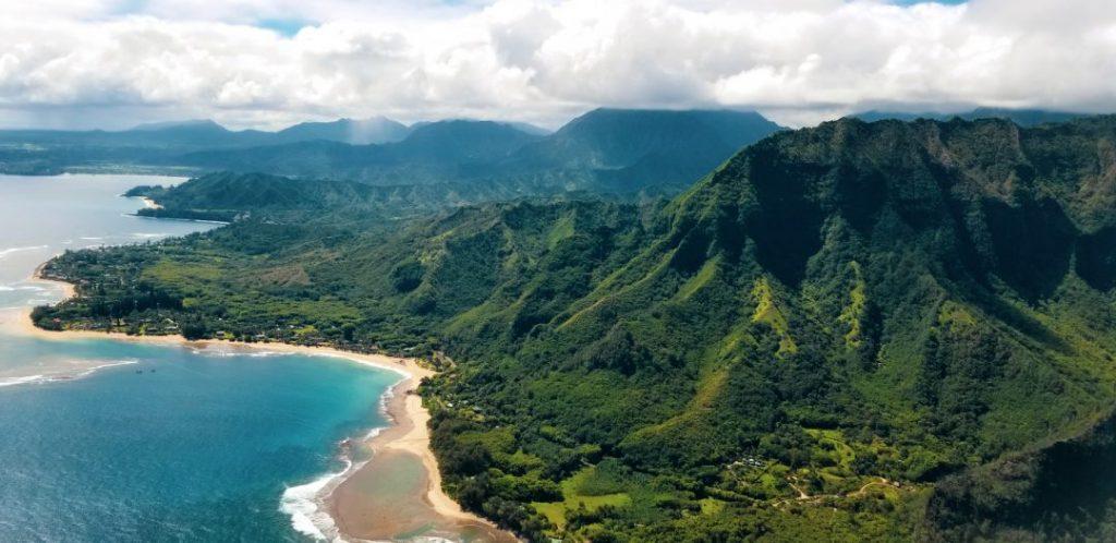 a green mountainous coastline in Hawaii