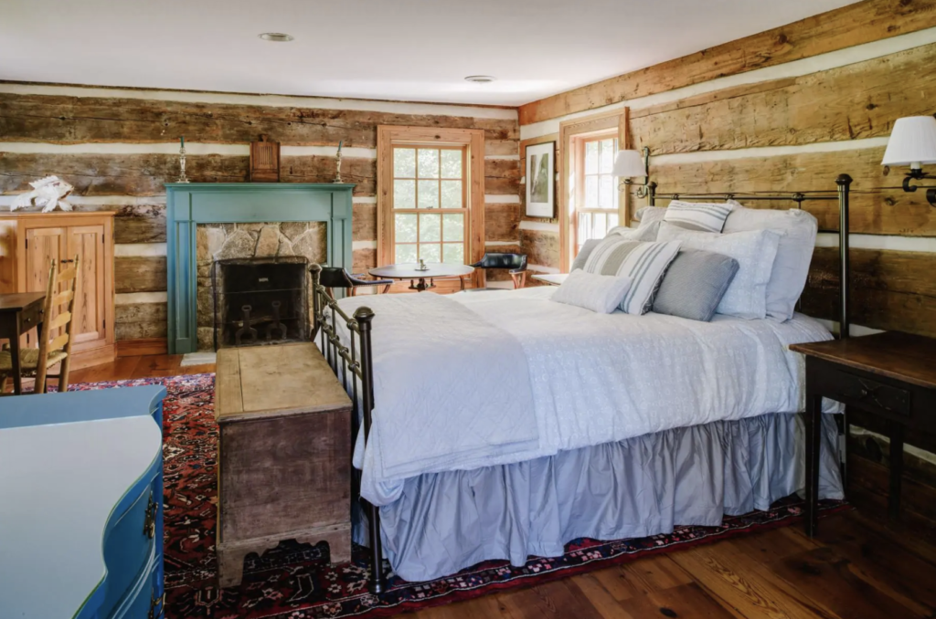 a super comfy looking bed in a log cabin