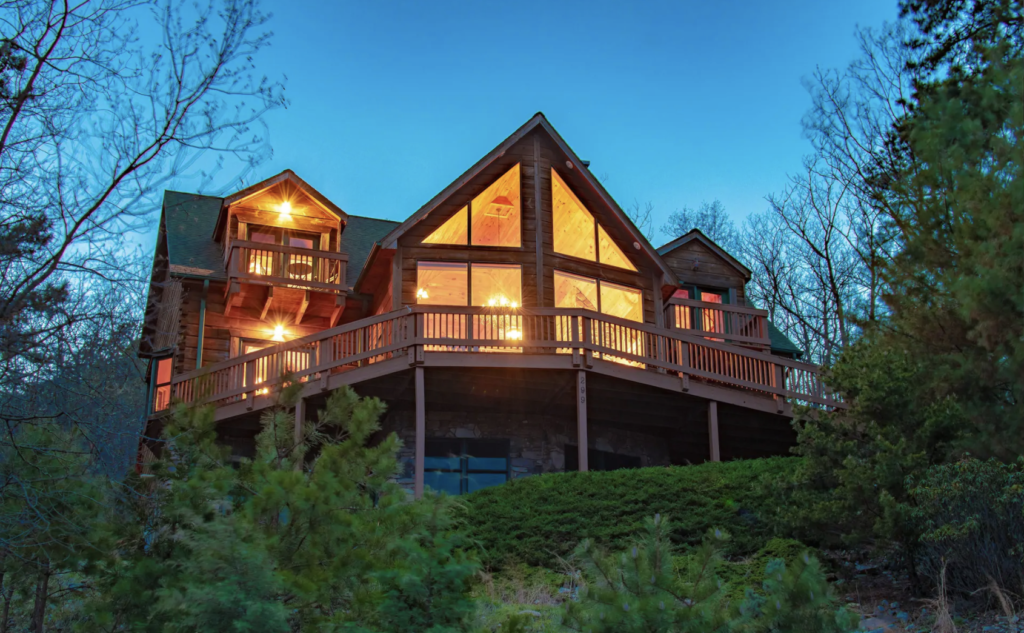 a large wood cabin with floor-to-ceiling windows - shenandoah national park cabins