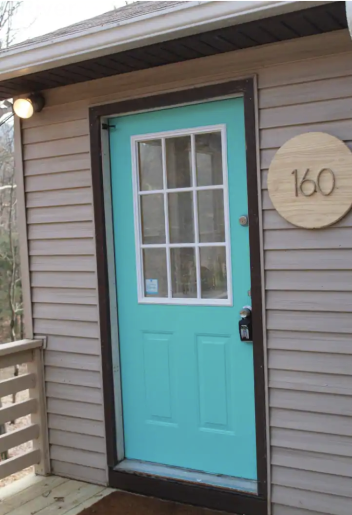 a bright turquoise door at one of the shenandoah national park cabins