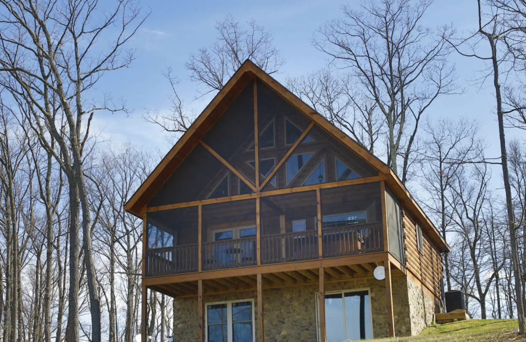 a shenandoah national park cabin with traingle roof and lots of windows