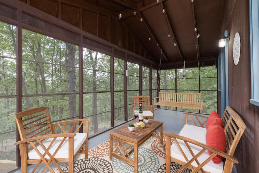 wood patio furnature on a cabin balcony