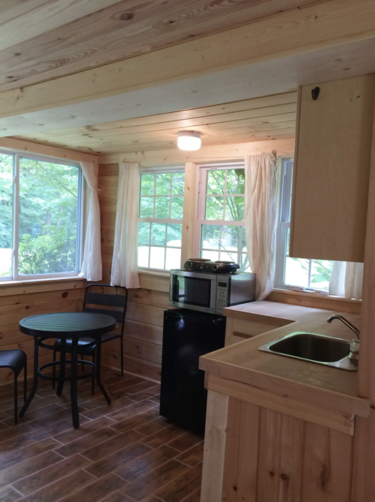 a small, wood-plank kitchen