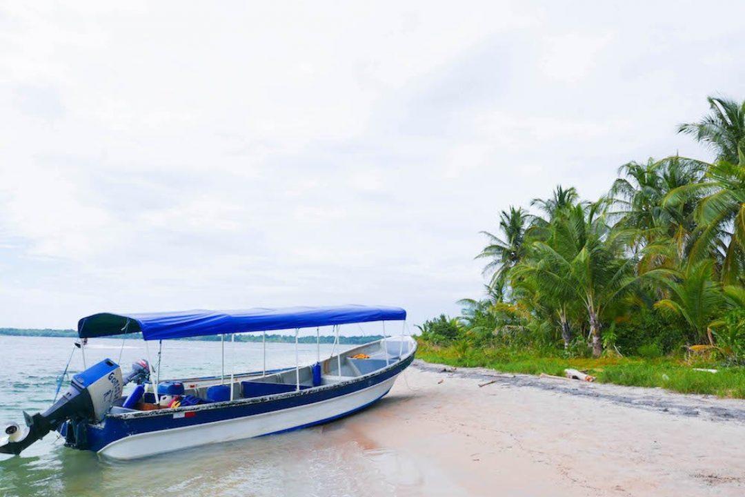 Boat on the each on Isla Colon, Bocas del Toro, Panama